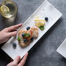 陶瓷餐具定?#25340;?#24847;长条盘纯白日式长方形寿司盘点心烤肉盘定制logo
