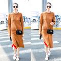 何穗机场秀同款姜黄色慵懒风针织宽松毛衣撞色开叉半裙套装F1065