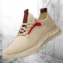 男鞋新款潮流時尚休閑運動風單鞋韓版飛織跑步鞋一件代發