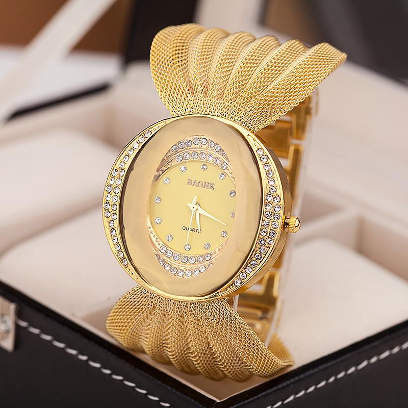 مبيعات المصنع مباشرة من نماذج انفجار التجارة الخارجية البيضاوي العريض النطاق الذهب والفضة شبكة حزام ساعات السيدات أزياء الساعات نيابة عن