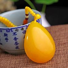 波羅的海琥珀蜜蠟雞油黃水滴型手工打磨男女款項鏈吊墜掛件批發