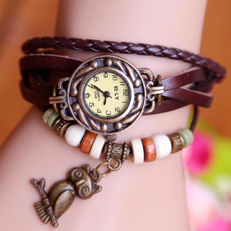 Mặt dây chuyền Owl Vòng đeo tay đồng hồ đeo tay nữ Da nhiều lớp bọc học sinh Trẻ em mới Đồng hồ tròn Cặp đôi