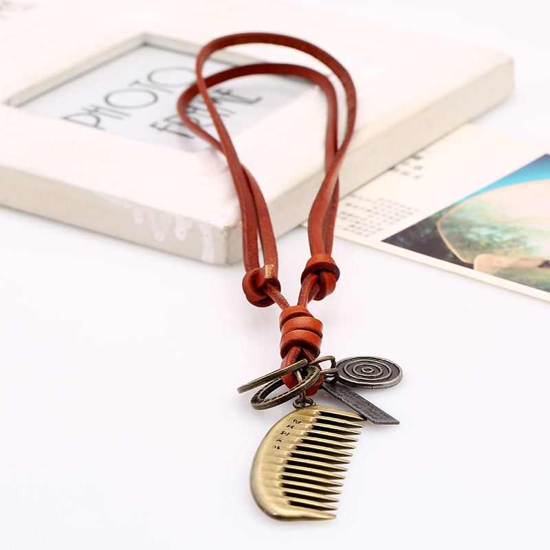 Vintage alloy comb leather rope pendant leather necklace sweater chain NHPK191574