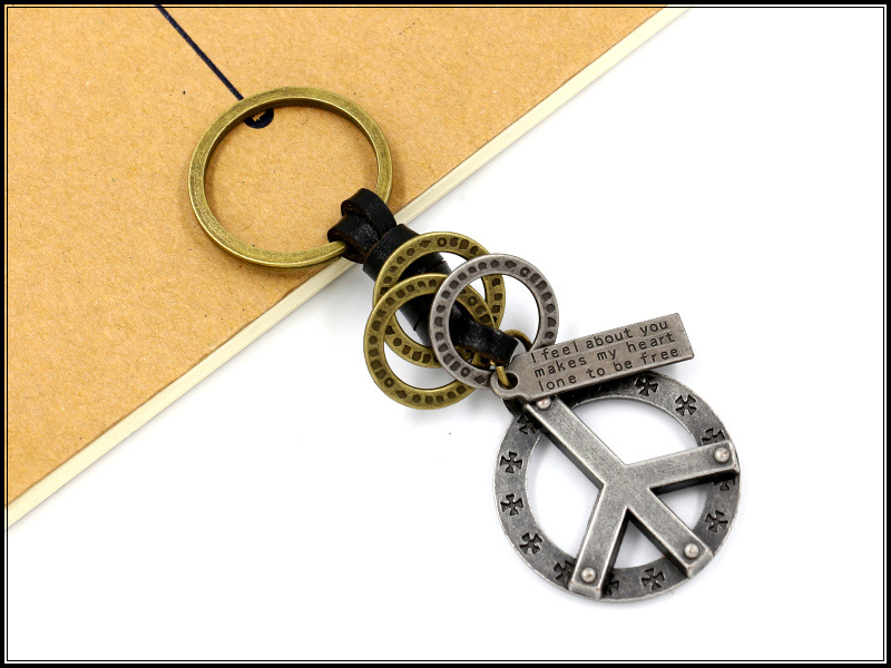 Vintage peace key ring wholesale leather braided key pendant leather keychain boys accessories NHHM194449