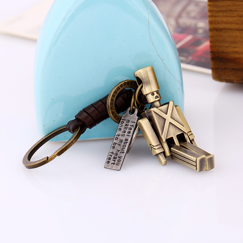 Pure handwoven leather key chain movable alloy robot key chain wholesale leather creative backpack pendant NHPK178089