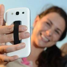 厂家直销创意手机支架背贴绷带弹性?#31181;?#25187;小礼品赠品定制logo批发