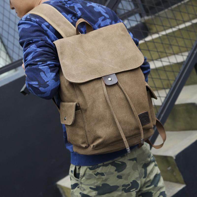 时尚潮流双肩包 男女通用休闲帆布旅行背包 高中大学生书包FM9116