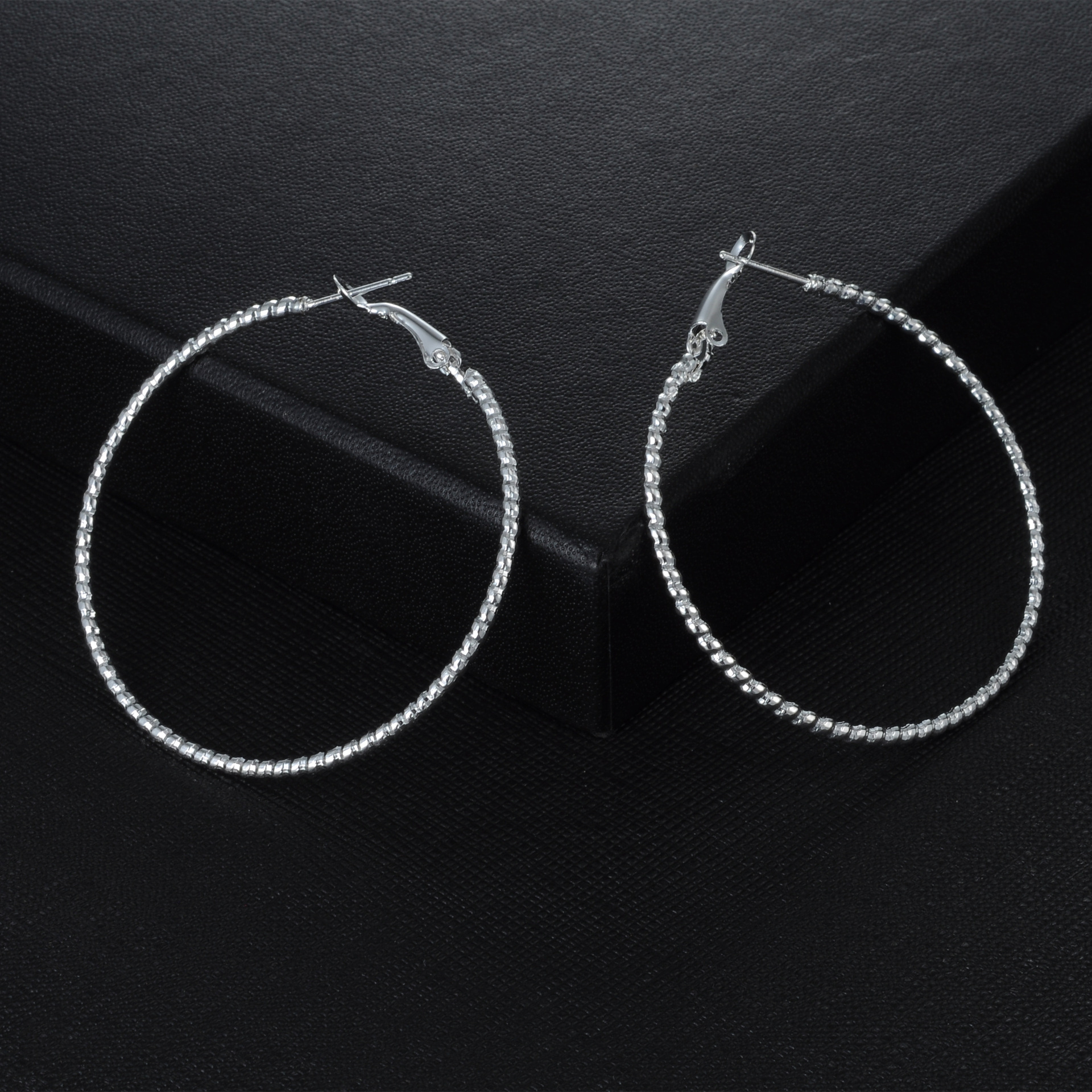 Star with the money crystal plating earring (Silver)NHIM0799-Silver