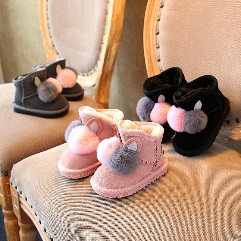 爆款童靴韩版可爱兔毛球球女童雪地靴真皮童鞋冬季保暖儿童棉靴子