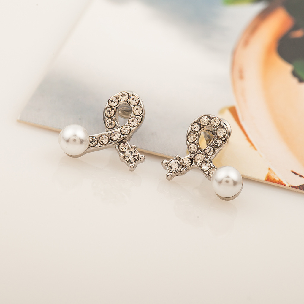 Fashion bow earrings silver plated inlaid pearl crystal earrings simple love earrings wholesale NHCU197225