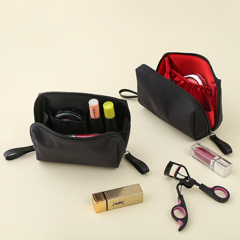DINIWELL韩版新品气质淑女尼龙防水便携手拿立体小号化妆包