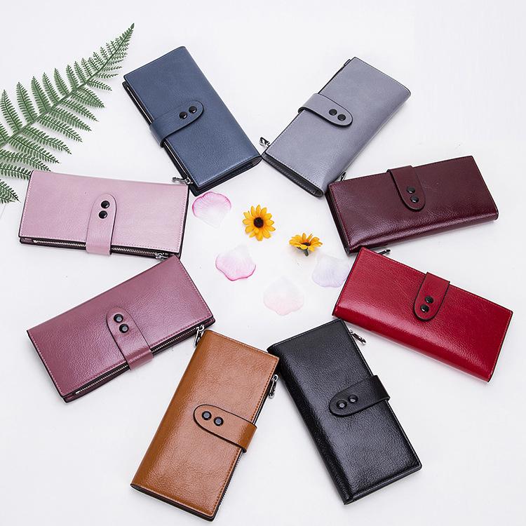亚美2021新款韩版女士手拿包双搭扣零钱包时尚大容量长款手袋批发