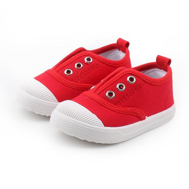 Giày trẻ em mùa xuân 2019 Giày trẻ em giày vải bé trai và bé gái một đôi giày đạp mẫu giáo trong nhà giày thông thường Giày vải trẻ em