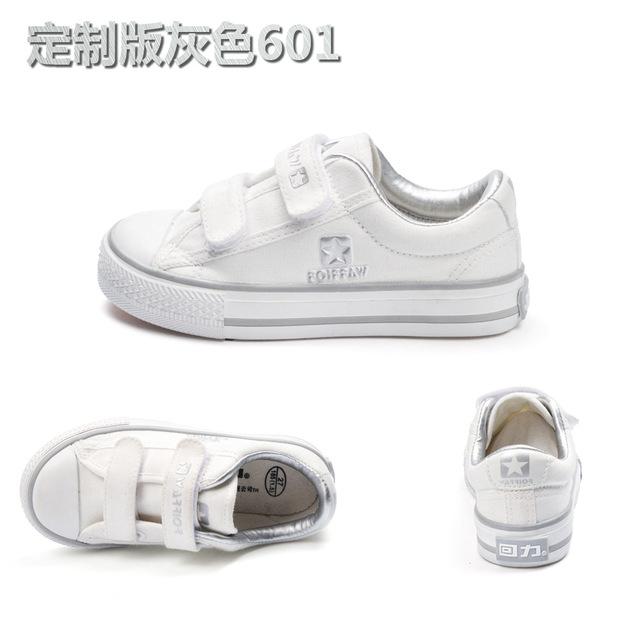 Giày trẻ em cổ điển Giày vải mùa xuân và mùa thu Chàng trai và cô gái giày trắng học sinh dán ma thuật giày đơn 601 Giày vải trẻ em