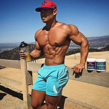 AE肌肉男健身訓練純棉透氣短褲跑步兄弟運動休閑三分褲潮一件代發