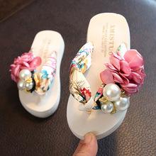 Mùa hè mới chống trượt cho trẻ em dép xỏ ngón thời trang giày đi biển pinch dép nữ hoa dép dép phụ nữ mặc Kéo cát trẻ em