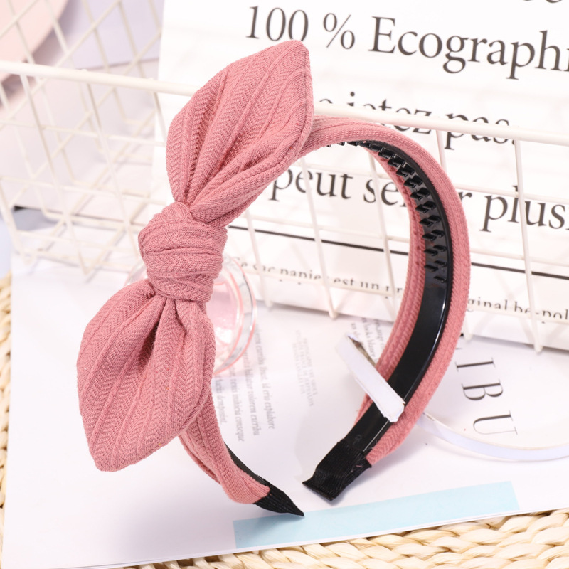 Simple Solid Color Knitted Striped Rabbit Ears Bow Wide Edge Toothed Non-slip Headband Headband NHDM205019