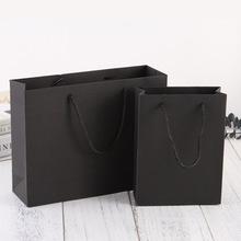 厂家批发定制黑卡纸皮鞋 服装手提袋 烫金UV印刷饰品礼品包装纸袋