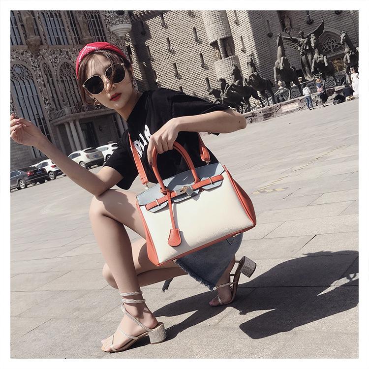 Fashion bag fashion handbag large shoulder bridal bag Kelly bag for women new Korean contrast color handbag  NHXC237904
