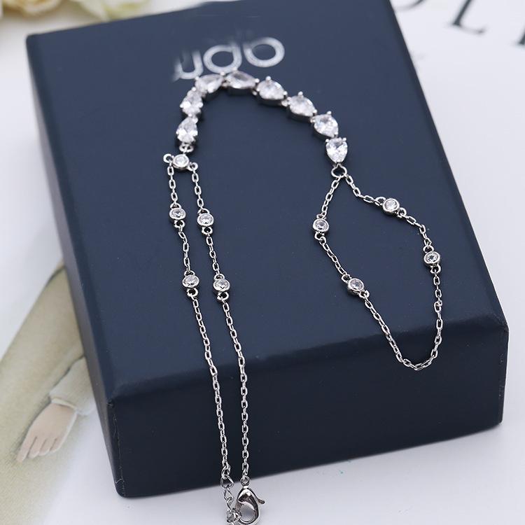 Sleek minimalist micro-inlaid water drops zircon hand back chain NHDO158524