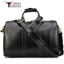 潮牛新款头层光皮手提旅行包男士大容量行李包真皮男包商务行李箱