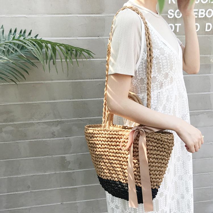 厂家直销新款丝带蝴蝶结草编包手提两用沙滩包编织包女包