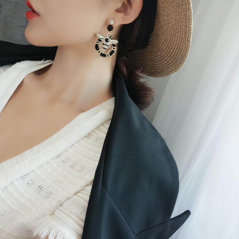Korean autumn and winter earrings cute bee flash drill earrings geometric weave winding handmade earrings wholesale nihaojewelry NHFT235379