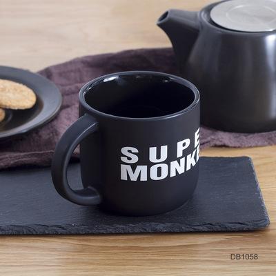 新品可爱卡通黑色马克杯定制LOGO磨砂陶瓷杯创意咖啡杯哑光水杯子