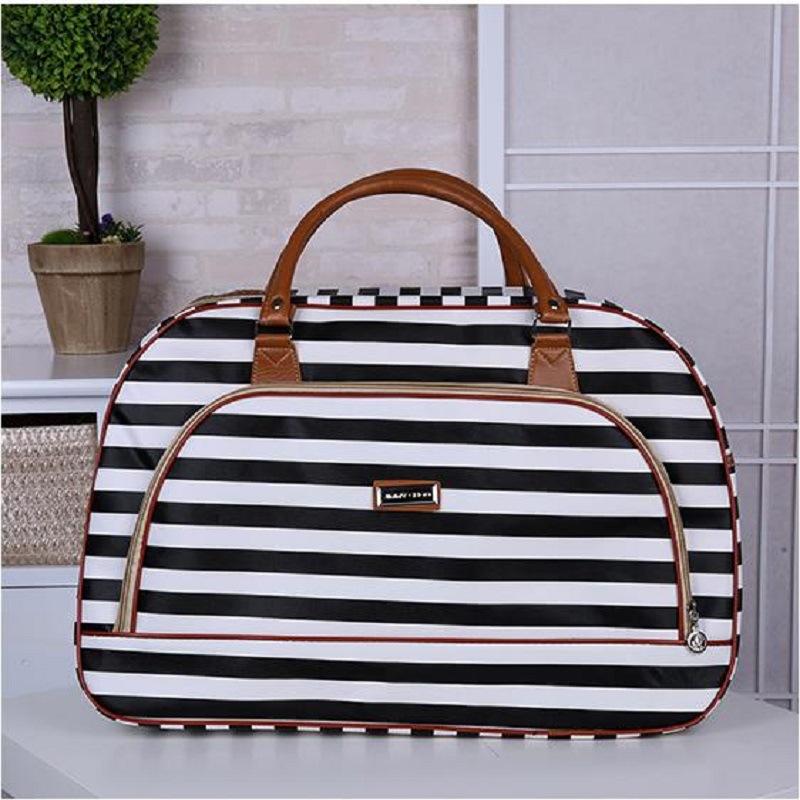 新款韩版大容量男女手提旅行包行李袋PU皮短途旅行袋旅游包行李包