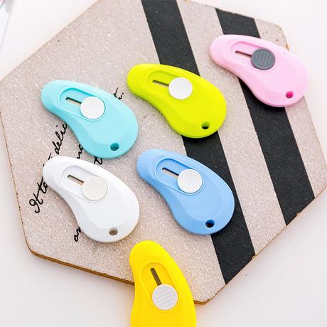 Kẹo sáng tạo màu dao tiện ích nhỏ Học sinh với dao mini express mở hộp thủ công nghệ thuật dao văn phòng phẩm