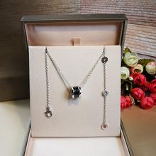 大牌专柜同款小红人弹簧项链慈善款 s925纯银黑陶瓷情侣项链