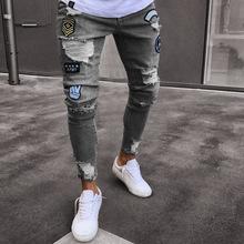欧美徽章男士牛仔裤潮流膝盖破洞拉链小脚裤破洞爆款男式牛仔长裤