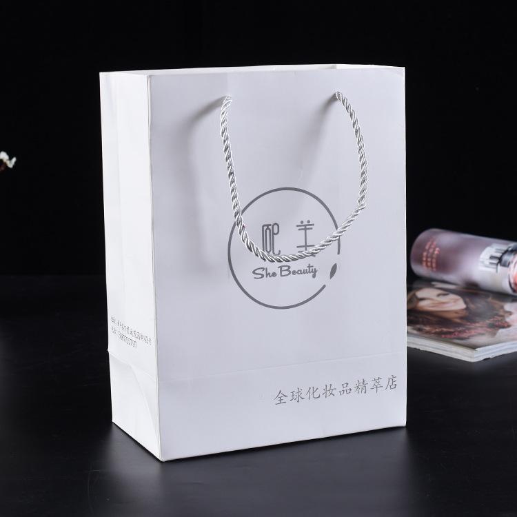 定做礼品服装化妆品购物pp手提袋 白卡纸袋定制 可印LOGO厂家定制