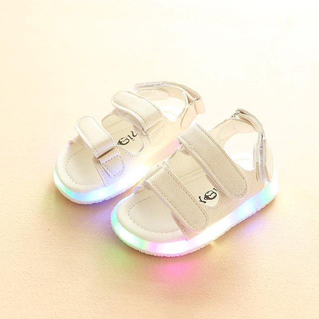Mùa hè giày trẻ em mới bán buôn Thời trang Hàn Quốc rắn màu Velcro đèn giày nam và nữ dép thủy triều Dép trẻ em