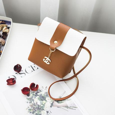 Bán buôn phiên bản tiếng Hàn mới của không khí đơn giản thời trang túi đeo vai hoang dã nhỏ màu tươi phù hợp với túi vuông nhỏ