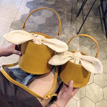 女包包親子水桶包包女2019新款蝴蝶結單肩包斜挎手提女包一件代發