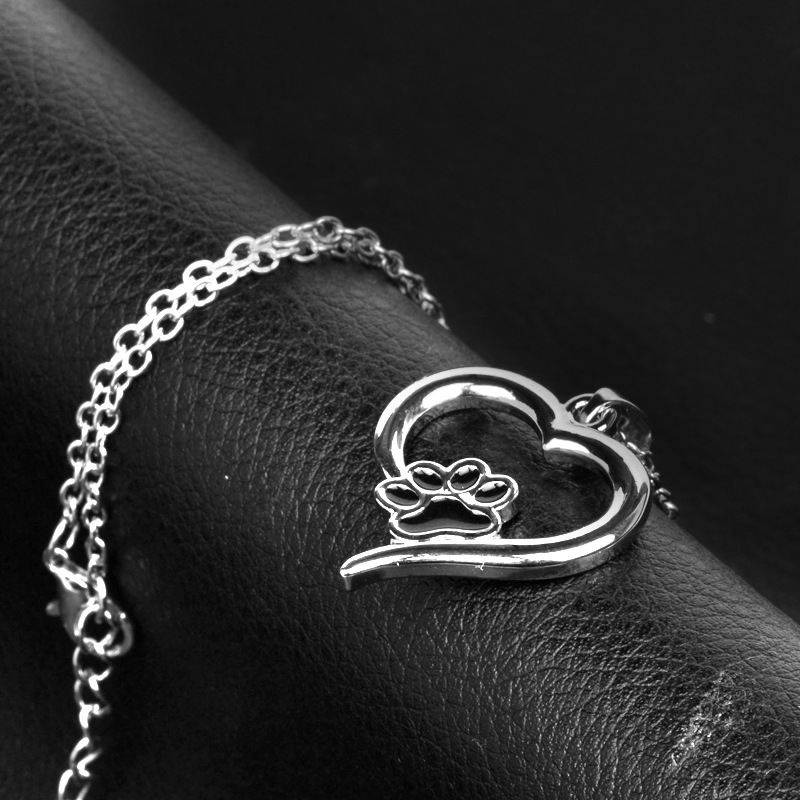 New fashion pet dog paw hollow love footprints necklace wholesale NHMO207896