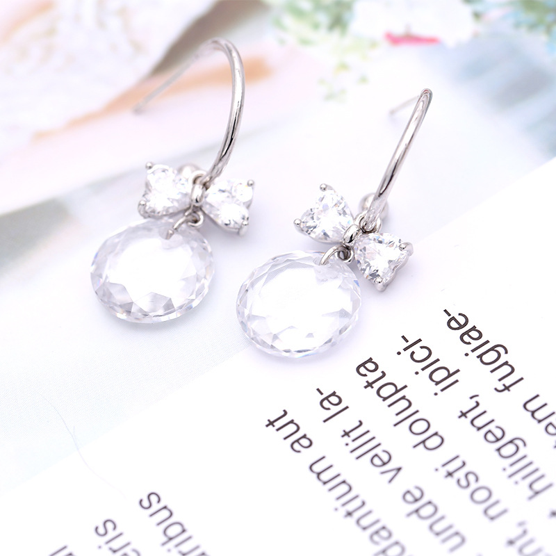 Korean version of the bow round transparent crystal earrings NHDO158530