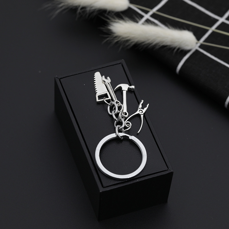 explosion keychain personality Father's Day gift tool four-piece metal keychain pendant jewelry wholesale nihaojewelry NHMO220444