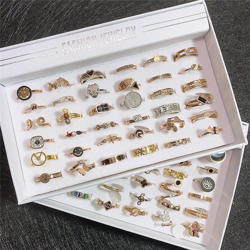 الأزياء الكورية الكلاسيكية التيتانيوم الصلب يتلاشى الغلاف الجوي وارتفع الذهب خاتم الأزياء والمجوهرات بالجملة الجديدة ييوو