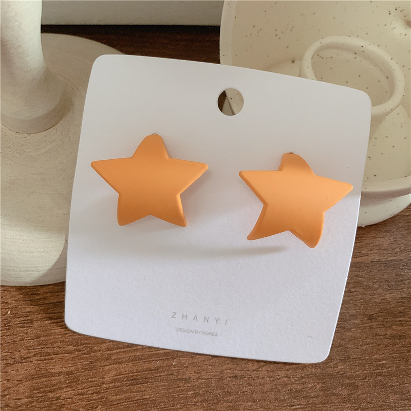 Candy-colored three-dimensional curled five-pointed star matte face earrings NHYQ145089