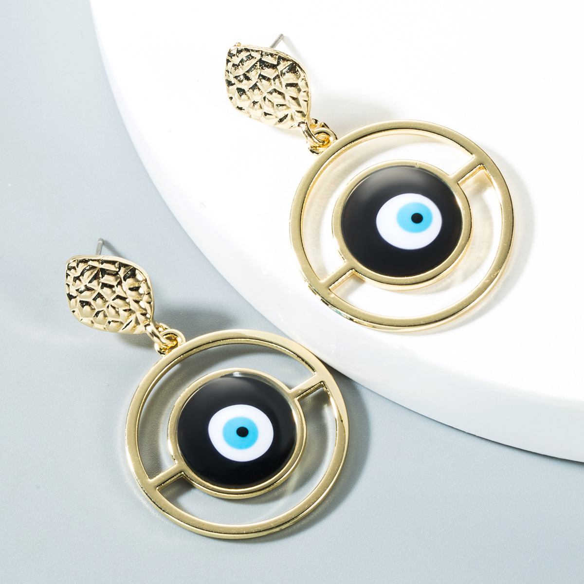 Blue eyed gold-plated earrings NHLN150809