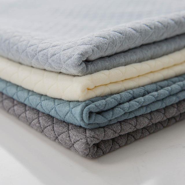 厂家现货 针织菱形大小格子提花空气层面料涤氨tr服装家纺染色布