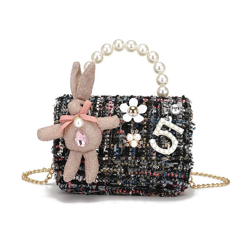 厂家直销2020新款韩版兔子数字挂件编织斜跨手提包可爱迷你儿童包