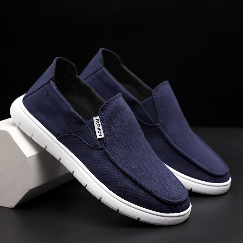 Flying fabric canvas shoes men's new summer 2019 one legged lazy shoes Korean fashion casual shoes board shoes men's shoes