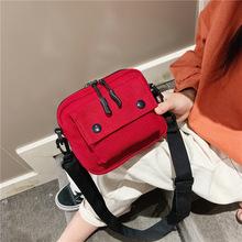 Phiên bản tiếng Hàn của túi trẻ em hoang dã dành cho bé trai và bé gái 2019 mới canvas giản dị màu đỏ thời trang đơn đeo vai Messenger Cặp học sinh