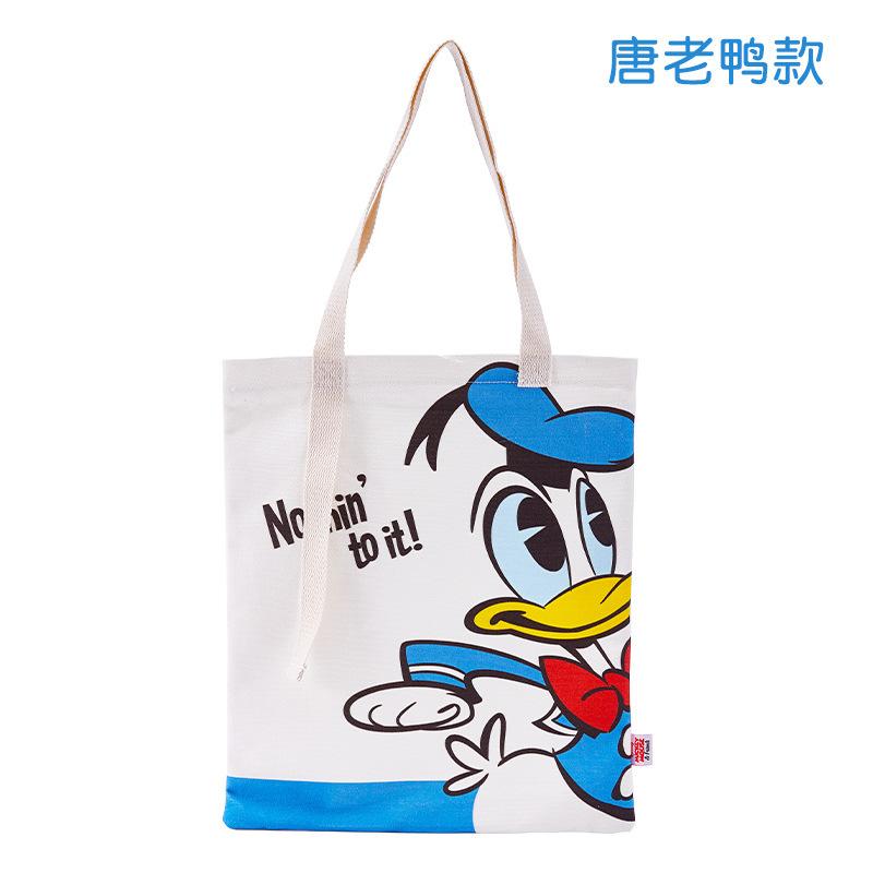 迪士尼纪念帆布包女可爱米奇单肩手提购物袋学生卡通唐老鸭帆布袋