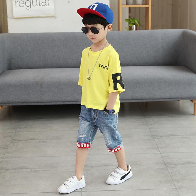 Quần áo bé trai mùa hè 2018 bé trai mới hè trẻ em bé trai tay áo ngắn đẹp trai hai mảnh phù hợp với quần áo thủy triều Bộ đồ trẻ em