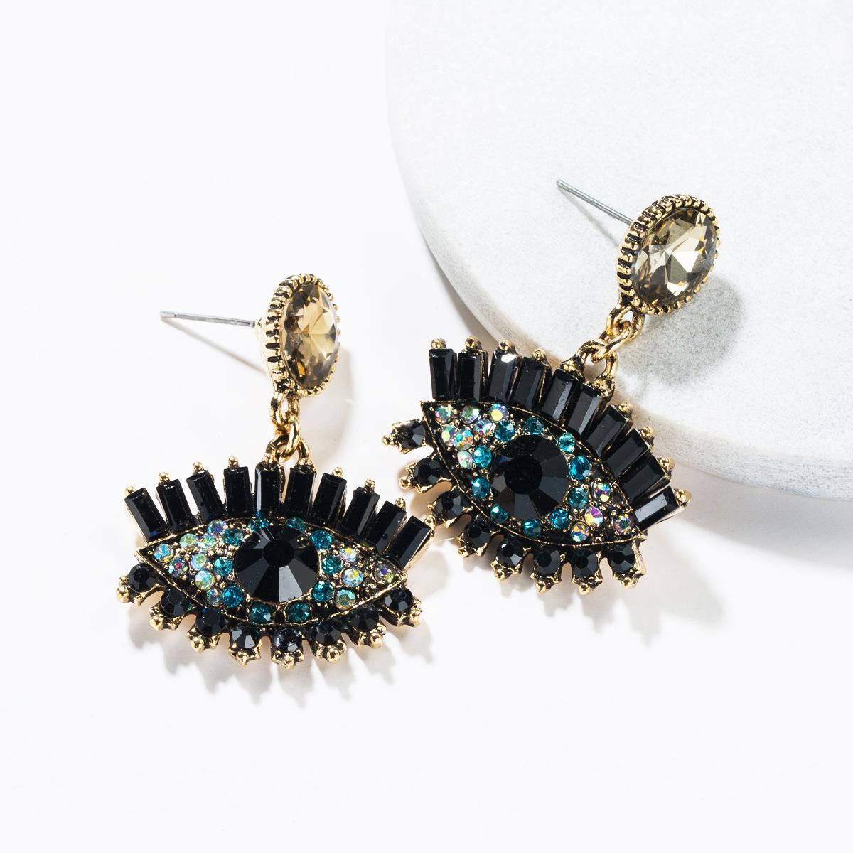 Fashion retro devil's eye alloy earrings NHJE138323