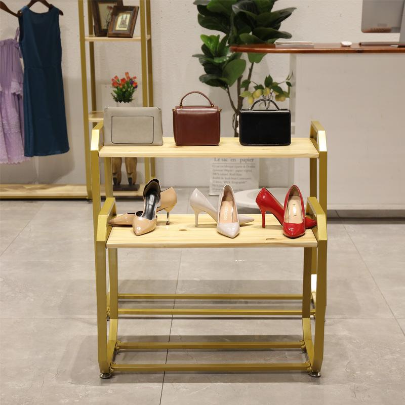 台童装高低架鞋包女装中岛式橱窗流水落地金色桌服装店展示直销包